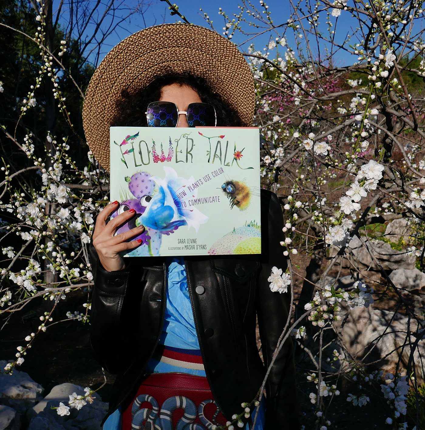 Flower Talk book by Masha D'yans reading in sakura